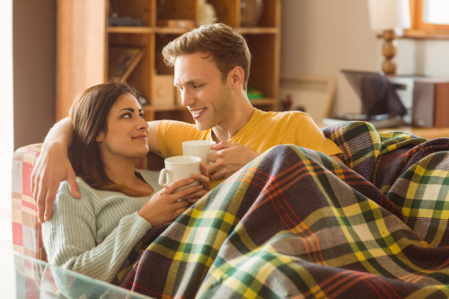 Couple on Couch enjoying furnace